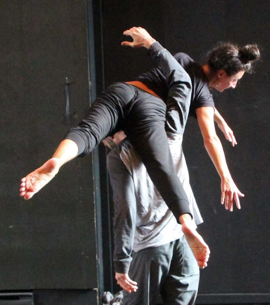 Alexia Buono dancing, balancing on a man's shoulders